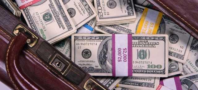 На чемодане с деньгами. Во что Украине обходится благоденствие десятка олигархов